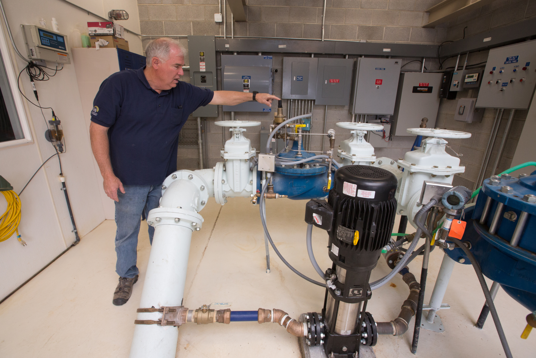Randy Randall, director of Public Works for Centerville City, Utah, has an enthusiastic approach to his job that helped earn the utility recognition for its accomplishments. His understanding of the energy inherent in moving water and passion for meticulous testing has saved the city hundreds of thousands of dollars in power costs. Here, Randall shows how using a small Baldour Reliance Super E Motor to pump at a lower pressure than is traditional helps to pump water in circles and keep the system pressurized, saving demand charges. (Photo By Sallie Shatz)