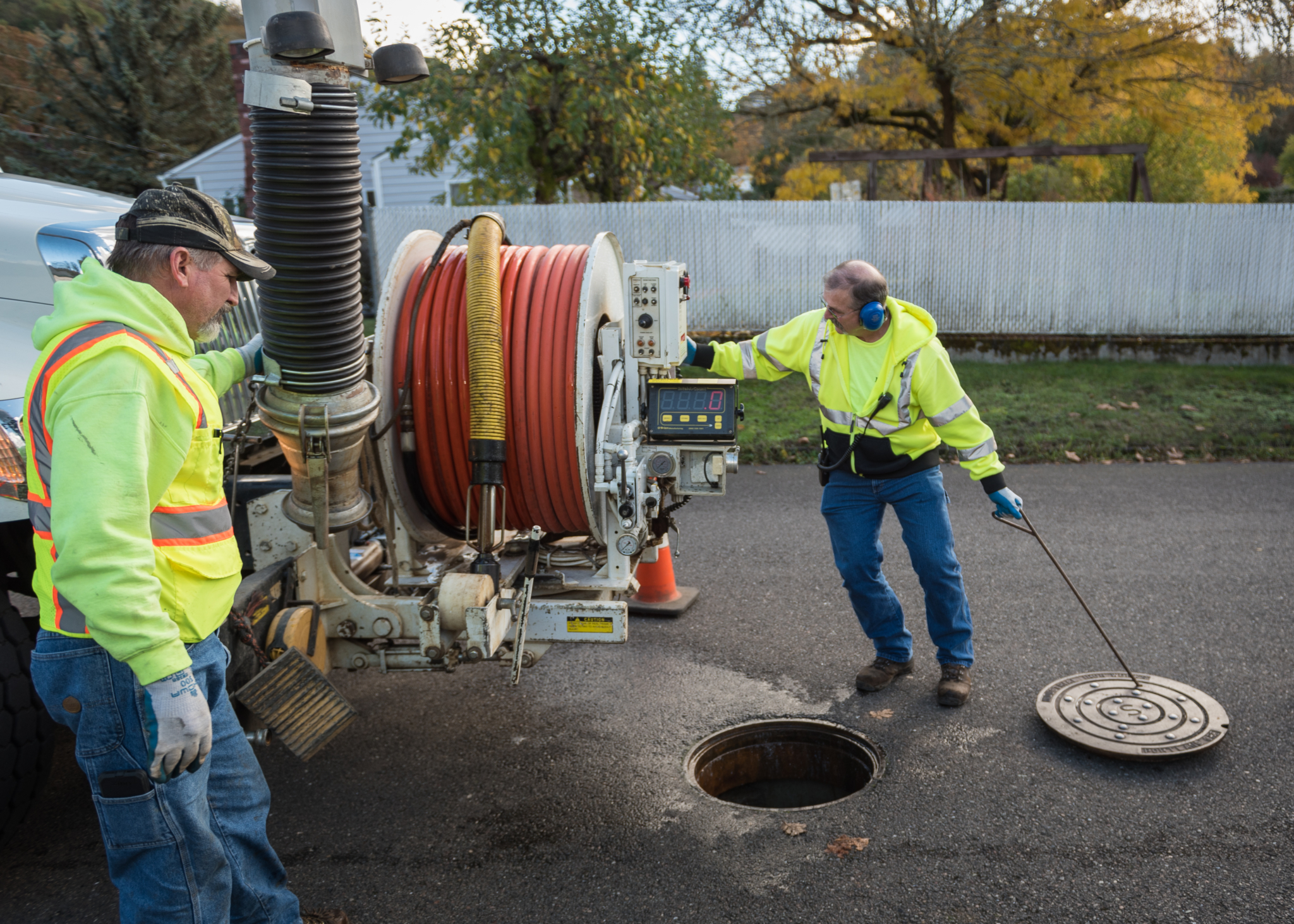 After being tasked with taking the Roseburg Urban Sanitary Authority's 160-mile system from a 10-year inspection cycle to a seven-year cycle, system operator Dean Ronk had his work cut out for him. But somehow, he has managed to get through it on a 6.4-year completion while running the program on his own. Above, Ronk is replacing a manhole after using a combination machine to clean a sewer line. (Photo By Ethan Rocke)