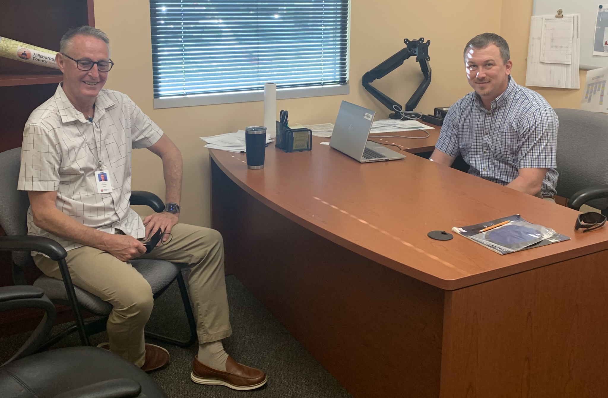 Outgoing director Rich Cummings (left) and incoming director Chris Jones discuss water/wastewater strategies for Hillsborough County's future.