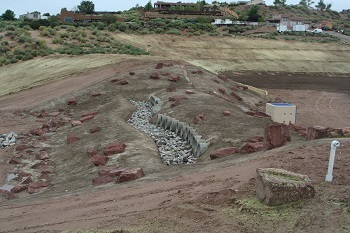 "The Southern Sandoval County Arroyo Flood Control Authority designed a flood control area in the sandy desert hills between Rio Rancho and Corrales that uses a ""living screen"" plant colony to filter out stormwater debris and barrier rocks to prevent sediment buildup."