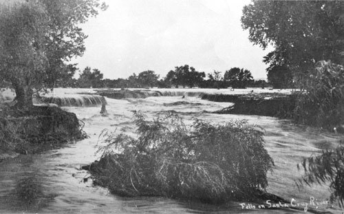 This is an old photograph showing waterfalls along the Santa Cruz River in downtown Tucson in 1889.
