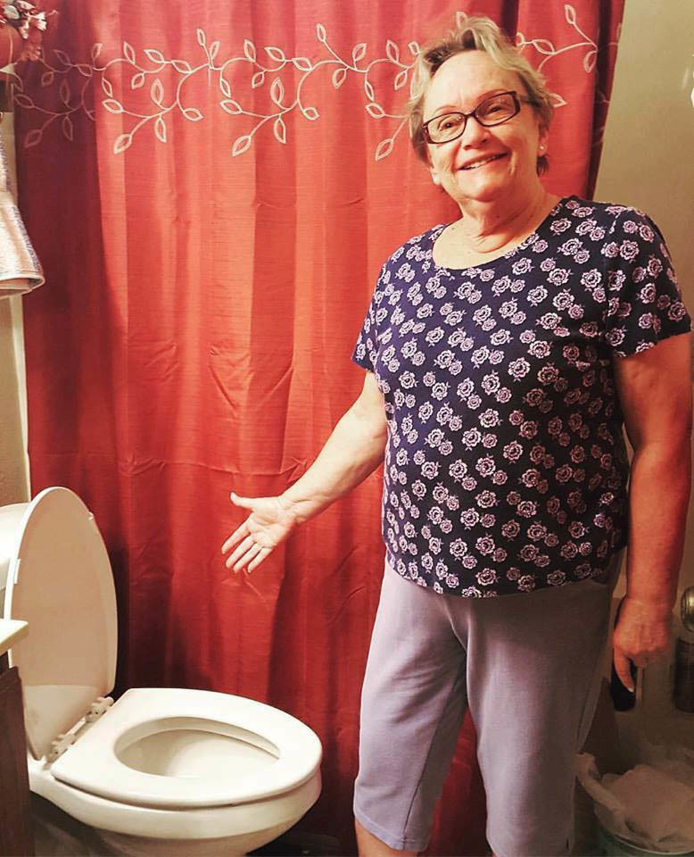Gloria LeMay shows off her high-efficiency toilet, purchased with help from the Toilet Rebate Program. (Photo Courtesy of City of Madison - Madison Water Utility)