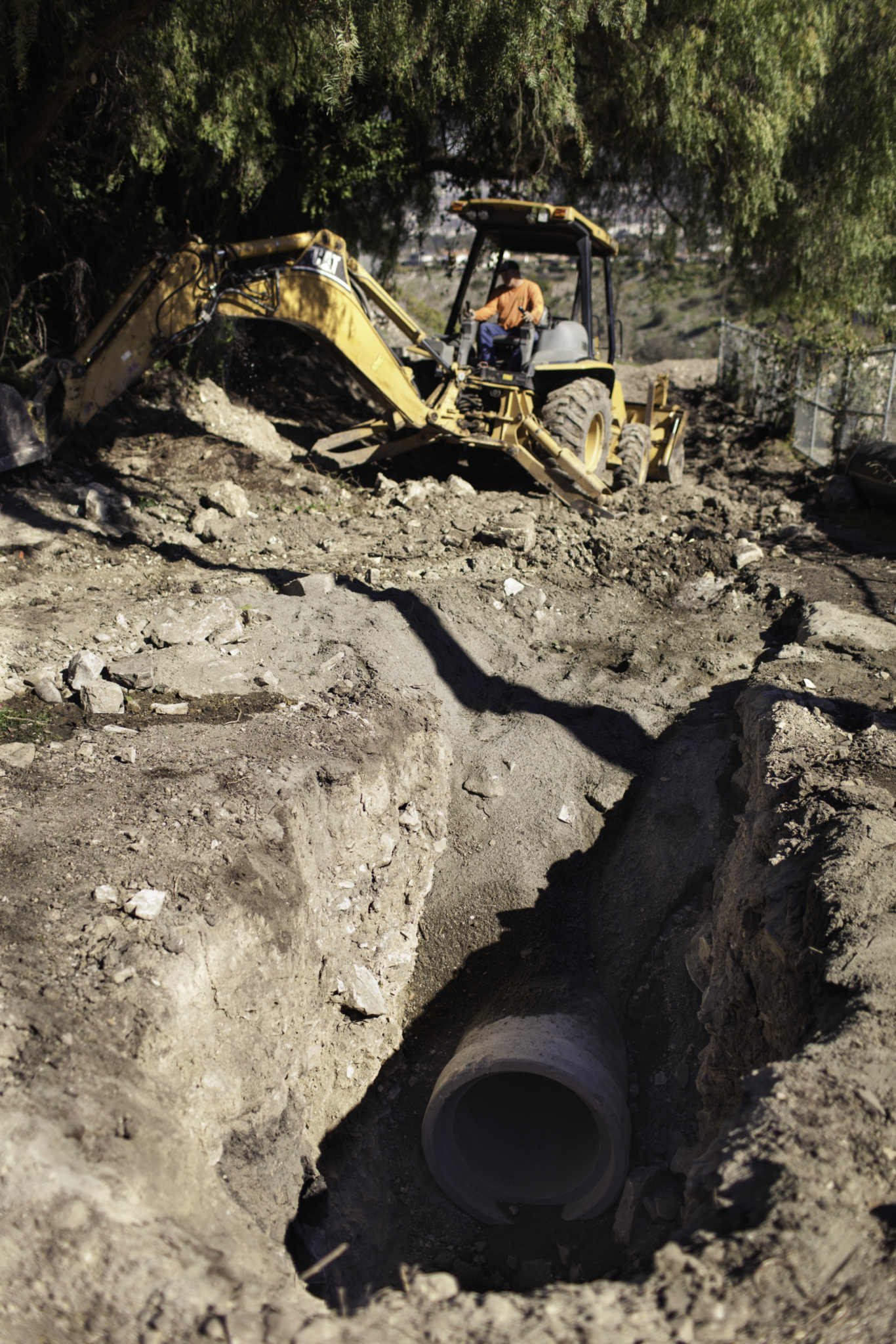 The city manages contracts with outside firms to handle construction needs, including this pipe replacement project initiated by a weathered steel pipe that led to a sinkhole.